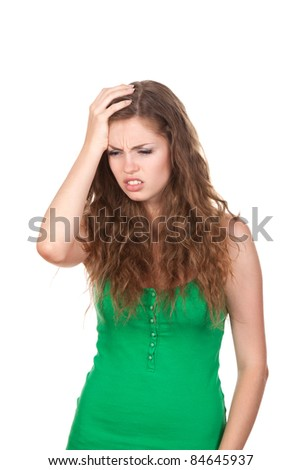 portrait of attractive depressed teenage girl hold hand on head - stock photo