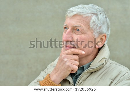 Portrait of attractive elderly man closeup outdoors