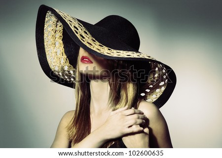 portrait of attractive elegant sexy woman with black hat - retro style - stock photo