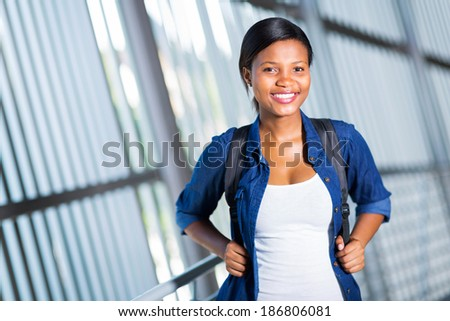 portrait of attractive female african college student - stock photo