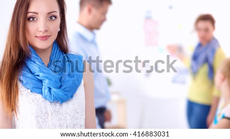Portrait of attractive female  designer in office - stock photo