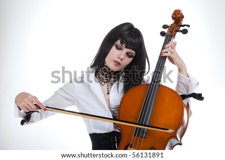 Portrait of attractive girl playing cello, studio shot over white background - stock photo