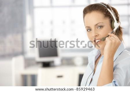 Portrait of attractive girl using headphones, smiling.? - stock photo