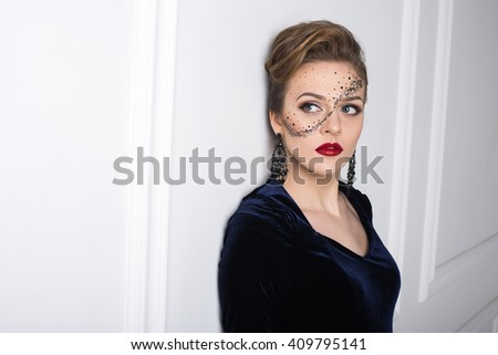 Portrait of attractive girl with art makeup posing on a white wall background in the studio. Different emotions and poses. Quality Face Retouch. The huge size of the image. - stock photo