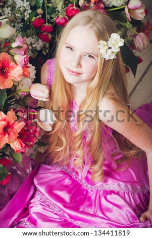 Portrait of attractive girl with long hair in flowers