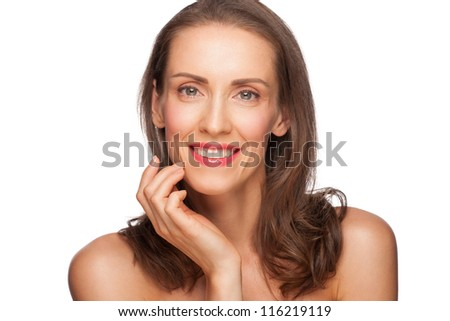 Portrait of attractive groomed healthy middle-aged woman touching her face, isolated on white background - stock photo