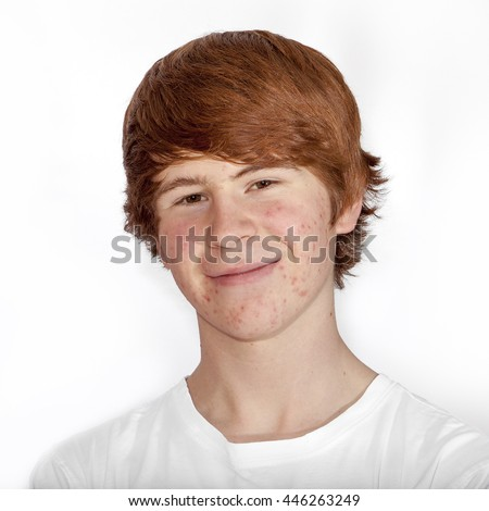 portrait of attractive happy boy in puberty - stock photo