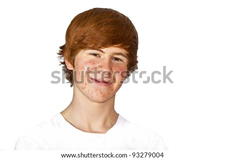 portrait of attractive happy boy in puberty