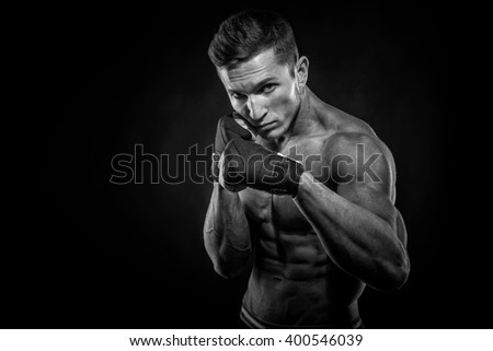 Portrait of attractive kickboxer in the dark.  - stock photo