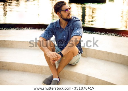 Portrait of attractive man ,casual clothes walk in Europe.Trendy young man,urban street style.Handsome mans look.street fashion,healthy and strong man,Casual young businessman.male model in his 30s. - stock photo