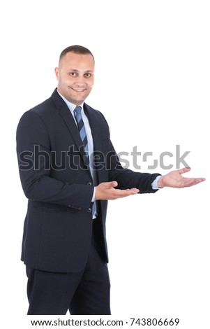 Portrait of attractive man in formal suit, presenting something. Isolated on white background.