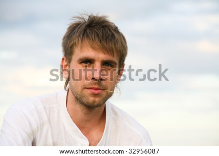 Portrait of attractive man in white t-shirt at summer - stock photo