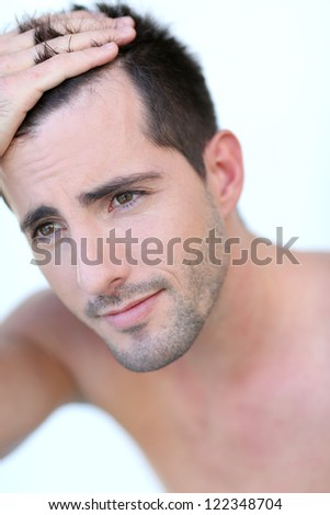 Portrait of attractive man with hair concern