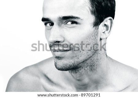 Portrait of attractive man, young handsome male model- made in studio on white background, black and white version - stock photo