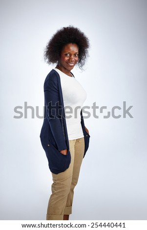 Portrait of attractive mature woman in casual wear standing on white background - stock photo