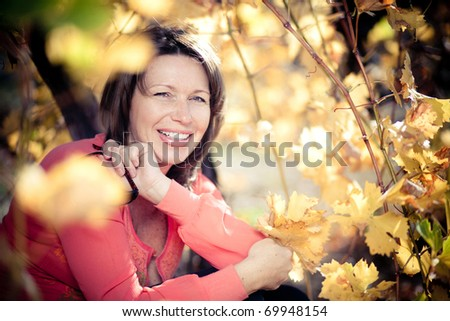 Portrait of attractive mature woman outdoor - stock photo