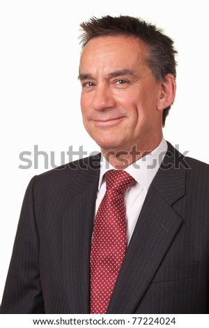 Portrait of Attractive Middle Age Business Man in Suit with Cheeky Smile - stock photo