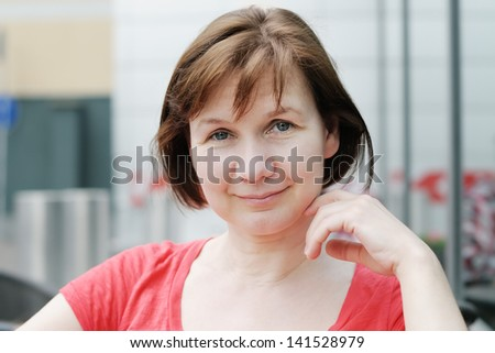 Portrait of attractive middle age woman - stock photo
