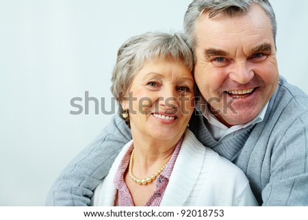 Portrait of attractive middle woman and man looking at camera