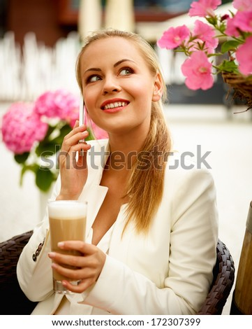 Portrait of attractive secretary on a lunch with phone - stock photo