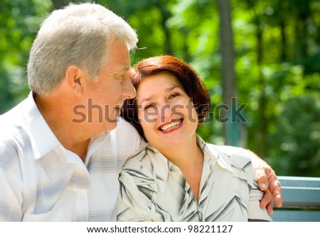 Portrait of attractive senior happy smiling cheerful couple embracing, outdoors