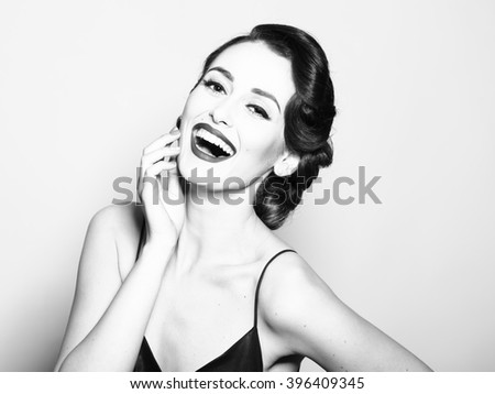 Portrait of attractive sensual glamour retro elegant young adult smiling woman with classic hairstyle and red lips in silk night dress indoor black and white, horizontal picture - stock photo