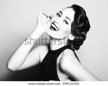 Portrait of attractive sensual glamour retro elegant young adult smiling woman with classic hairstyle and red lips in evening dress indoor black and white, horizontal picture