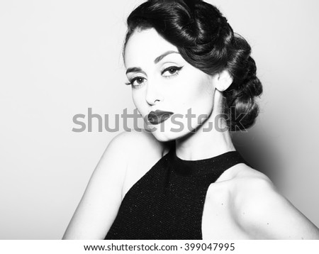 Portrait of attractive sensual glamour retro elegant young adult thoughtful woman with classic hairstyle and red lips in evening dress indoor black and white, horizontal picture - stock photo