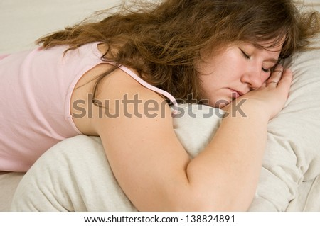 portrait of attractive sleeping woman - stock photo