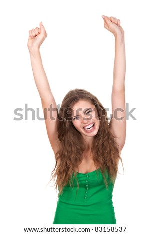 portrait of attractive smile teenage girl holding arms and hands up wear green shirt, with brown long hair, isolated over white background concept of happy student, young pretty winning success woman - stock photo