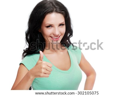 portrait of attractive smile teenage girl show thumbs up gesture, in green shirt, with white teeth, black long hair, isolated over white background concept of success happy student, young pretty woman - stock photo