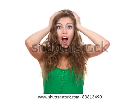 portrait of attractive surprised excited scared screaming teenage, hold hands on head, open mouth with brown long hair, isolated over white background concept of worried student, young pretty woman - stock photo