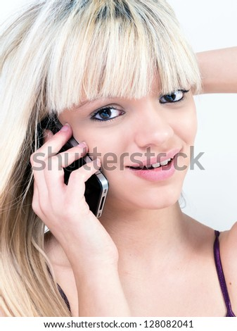 Portrait of Attractive teen girl smiling while phoning - stock photo