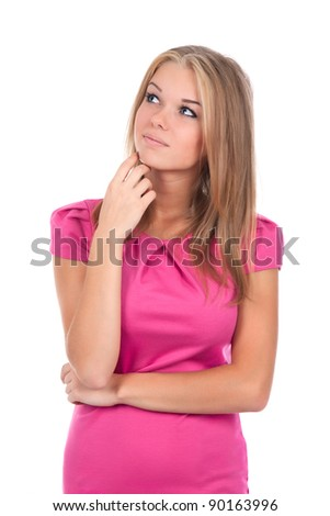 portrait of attractive teenage girl smile think looking up in pink dress, isolated over white background - stock photo