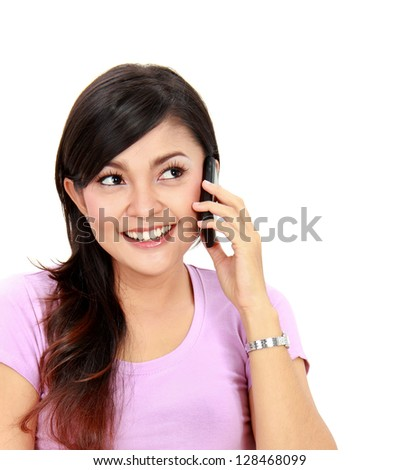 Portrait of attractive teenager talking on her mobile phone - stock photo
