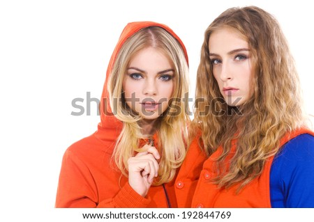 portrait of attractive two girl standing isolated  - stock photo