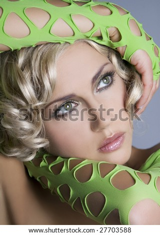 Portrait of attractive woman in green gloves - stock photo