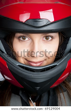 Portrait of attractive woman in motorbike helmet - stock photo