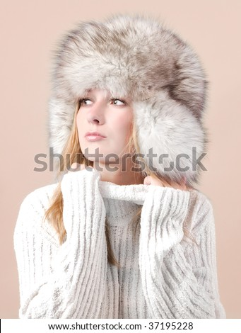 Portrait of attractive woman in winter style - stock photo