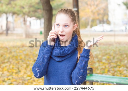 Portrait of attractive woman talking on mobile phone - stock photo