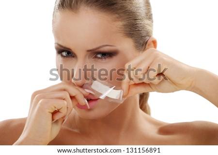 Portrait of attractive woman waxing upper lip - stock photo