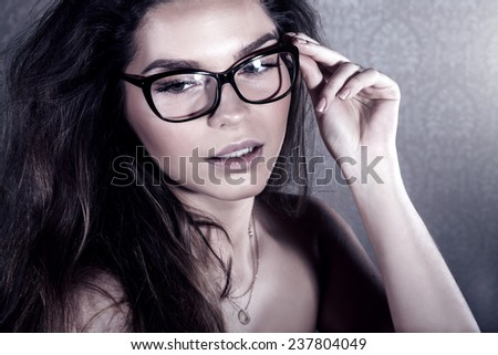 Portrait of attractive woman wearing glasses.