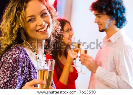 Portrait of attractive woman with charming smile on the background of couple - stock photo