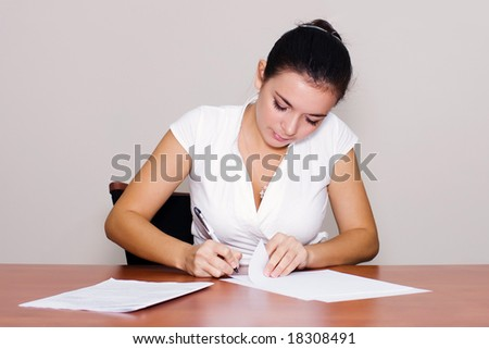 Portrait of attractive woman with documents