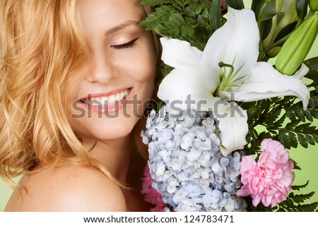 Portrait of attractive woman with flower smiling - stock photo