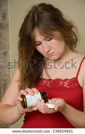 portrait of attractive woman with pills
