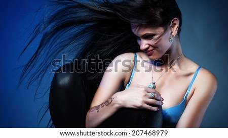 Portrait of attractive woman with streaming hair. Color cross processed - stock photo