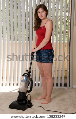 portrait of attractive woman with vacuum - stock photo