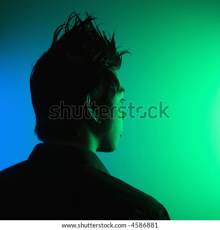 Portrait of attractive young Asian man with spiked hair. - stock photo