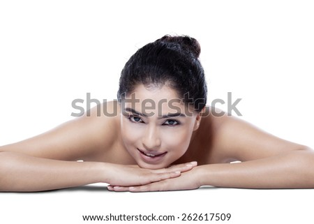 Portrait of attractive young asian woman with fresh skin enjoy relaxation in the studio - stock photo